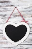 den svarta tavlan i hjärtform foto