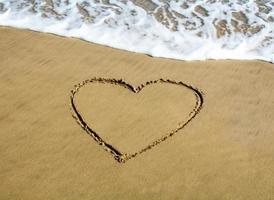 hjärta dras på stranden