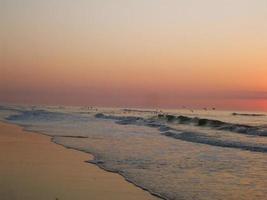 strandsoluppgång 4 foto