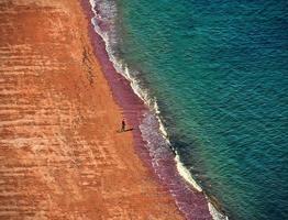 röd strand foto