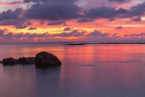 solnedgång vid stranden foto