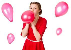 flicka med röda ballonger foto