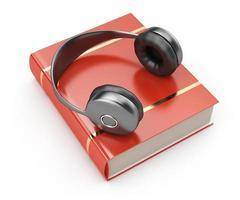 hörlurar och bok foto