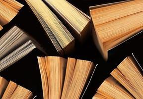 böcker på svart bakgrund, ovanifrån foto