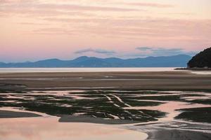 solnedgång i Abel Tasman nationalpark