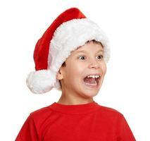 vinterferie jul koncept pojke i santa hatt på vitt