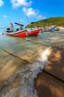 våg, kust, båtar foto