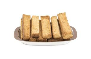 torra toastpinnar på ett fat