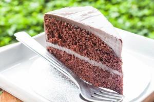 dubbel choklad vaniljsås tårta foto
