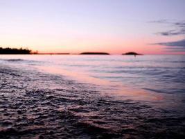 solnedgång vid bukten foto