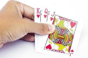 spelkort i en hand