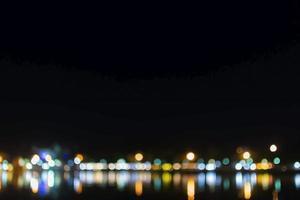 bokeh tänder bakgrund av staden foto