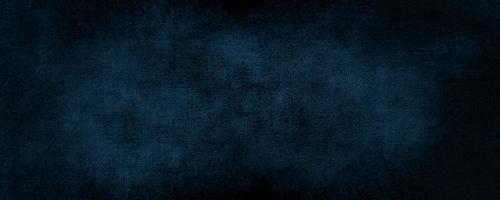 abstrakt mörkblå färgbakgrund med repad modern bakgrundsbetong med grov struktur, svarta tavlan. konkret konst grov stiliserad konsistens foto