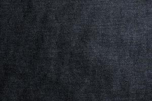 mörk bomulls denim bakgrund foto