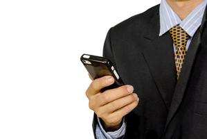 affärsman som håller en smart telefon foto