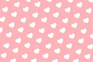 mönster av vita hjärtan på rosa bakgrund för alla hjärtans dag gratulationskort