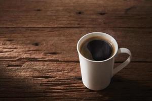 kaffe på trä foto