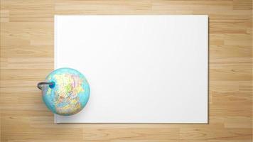 världen på papper på träbakgrund foto
