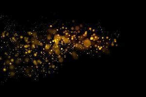 suddiga guldcirklar på svart bakgrund foto