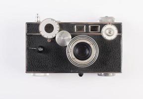 gammal vintagekamera på vit bakgrund foto