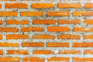 röd tegelvägg för textur eller bakgrund foto