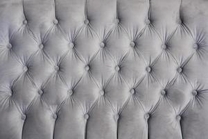 detalj av sammetgrå soffa för textur eller bakgrund foto