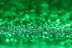grön glitter bokeh bakgrund foto