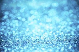 defocus av blått glitter