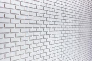 abstrakt vittrad textur färgade ny stuckatur ljusgrå och åldrad bakgrund för vit tegelvägg foto
