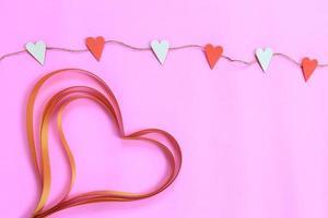Alla hjärtans dekor på rosa foto