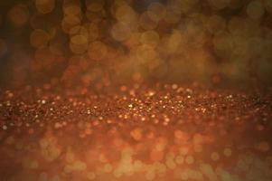 orange glitter bokeh bakgrund foto