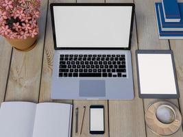 håna upp arbetsytan på bordet med anteckningsbok, surfplatta och telefon foto