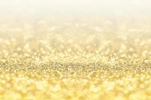 guld mousserande och bokeh bakgrund foto