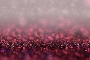 röd och lila gnistrande och bokeh bakgrund foto