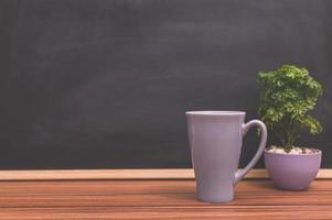 kaffemugg på skrivbordet