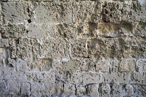 gammal slottvägg gjord av kalksten