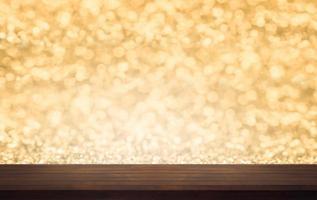 brun hylla med guld bokeh foto