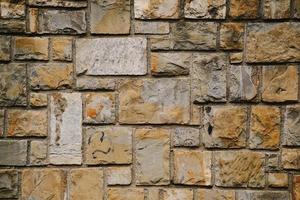 orange stenmur texturerad bakgrund foto