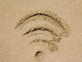 linjer ritade i en lapp sand för bakgrund eller konsistens foto