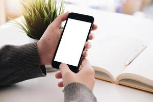 närbild kvinnans hand med blank skärm foto