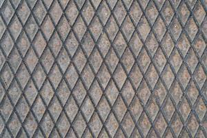närbild av en vittrad järnplatta foto