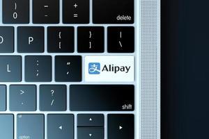 2018-- illustrativ ledare för alipay-symbolen över datorns tangentbord foto