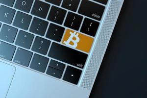 2018-- illustrativ ledare för bitcoin-ikonen över datorns tangentbord foto