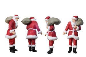 miniatyr Santa Claus bär en påse isolerad på en vit bakgrund