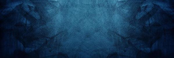 mörkblå cement eller betongvägg för bakgrund eller konsistens foto