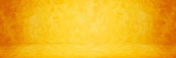 gul eller orange cement eller betongvägg för bakgrund eller konsistens foto