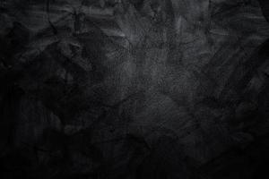 mörk eller svart cement eller betongvägg för bakgrund eller konsistens foto