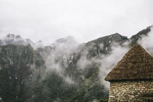 stenigt hus vid machu picchu, peru foto