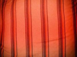rött tyg för bakgrund eller konsistens foto