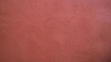 abstrakt bakgrund från röd stuckatur